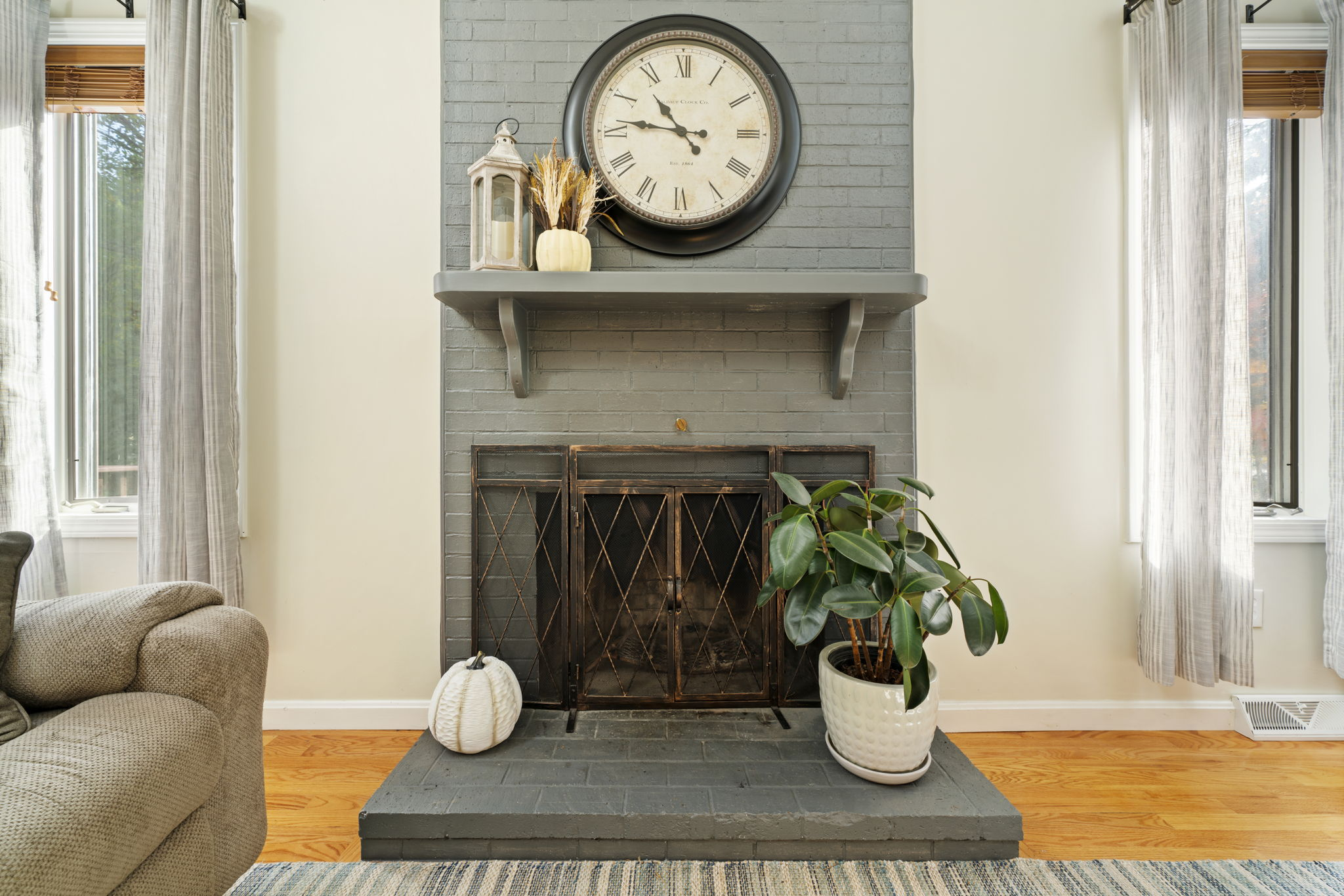 Stunning grey modern fireplace with iron gate and shelving above