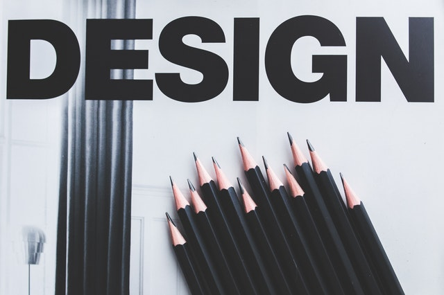 the word design with pencils