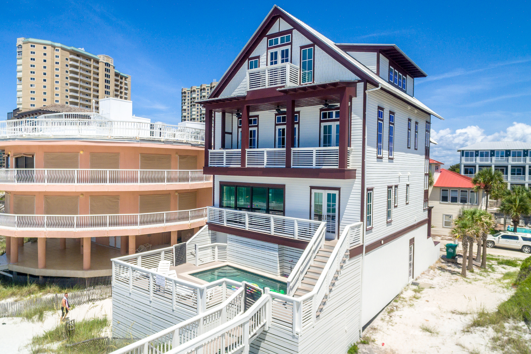 Perched high above sugary white sands, 259 Open Gulf Street captures  breathtaking views of emerald waters from its 4 stories of Gulf-front  balconies.