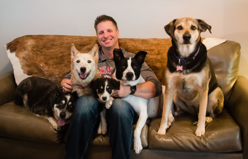 Charles Gilbert and his 5 dogs - Keller Williams Realtor
