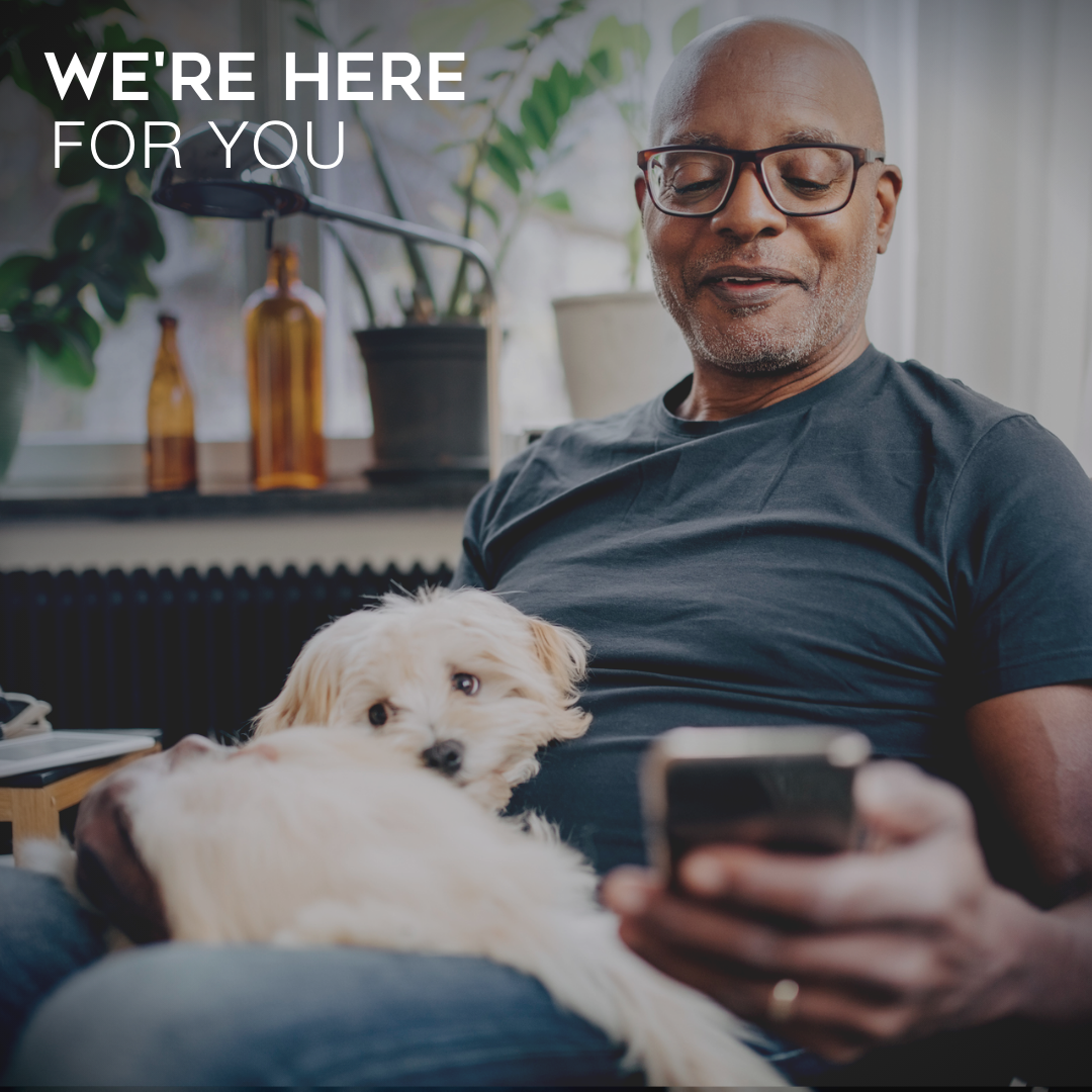 We're Here for You - Man Looking at Phone