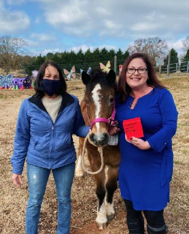 Amy McBride GIVES BACK to Butterfly Dreams Farm