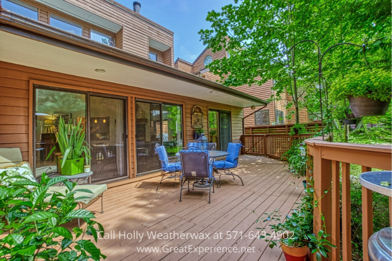 Reston VA home- Invite your friends over and have wonderful parties and get-togethers on the large deck of this Reston VA home.