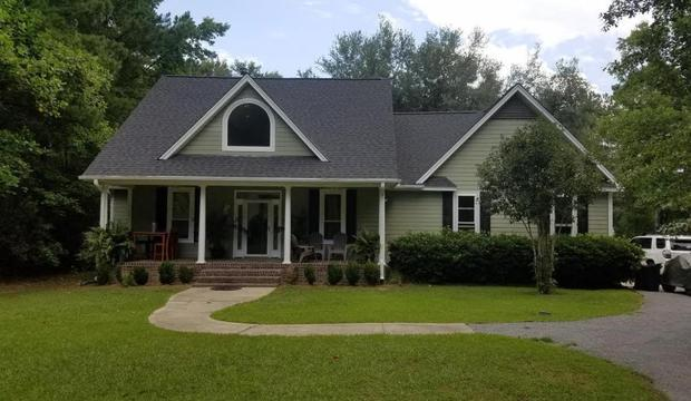 Beautiful 3 bed/2 bath home sits on 3 acres of peaceful country living and is less than 20 miles to downtown Charleston